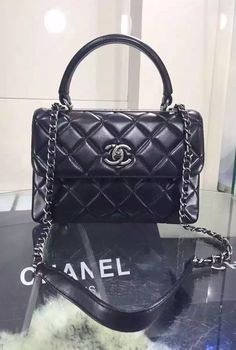 09a0e9a842ff This flap bag is distinctively different with its eye-catching silver metal  plate on the. Chanel BagsChanel ...