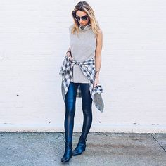 Leather leggings, a knit sweater, and a plaid shirt