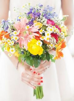 Replace the orange flowers with tiger lilies and add some hydrangeas and peonies in there and that's what I want the second time around! Color focus on the yellow since my bridesmaids will be in Tiffany Blue (these will be the Bridesmaid bouquets)