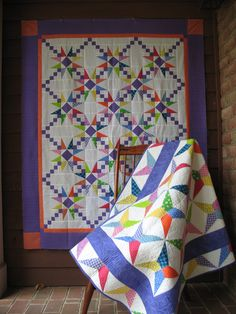 """Doubly Charmed, What do you call a pattern containing two charming companion quilts? Doubly Charmed, of course! You'll use the same set of 5"""" squares for both quilts. It's like magic! You'll cut the center beams from the squares for the first quilt and then you'll use the cutaways for the side triangles in the second. Two beautiful quilts out of one set of squares. Enchanting!"""