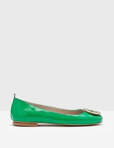 Shine on from morning to midnight in these polished patent leather flats. Despite their bright finishes and bold hammered disc embellishment, they're an easy-going shoe, with round toes and flat soles for all-day comfort, from the boardroom to the dance floor. A contrast ribbon is yet another eye-catching detail.