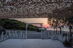 Sunset at baybeez Sykia. A Beach bar within a pine forest. What an amazing combination. Pine Forest, Beach Bars, Pergola, Outdoor Structures, Sunset, Amazing, Outdoor Pergola, Sunsets, The Sunset