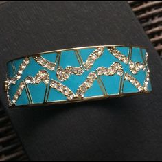 Kate Spade Hinge Bangle Turquoise Blue and rhinestones with gold designs encompass this gorgeous bangle bracelet by Kate Spade.  Pictures don't do it justice!  (A) kate spade Jewelry Bracelets