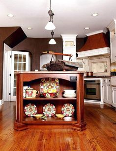 Cherry wood kitchen island with delightful kitchenware on display [Design: Normandy Remodeling] Kitchen Island With Seating For 6, Kitchen With Long Island, Kitchen Center Island, Portable Kitchen Island, Kitchen Island On Wheels, Rustic Kitchen Island, Kitchen Islands, Vintage Kitchen, Kitchen Island Australia