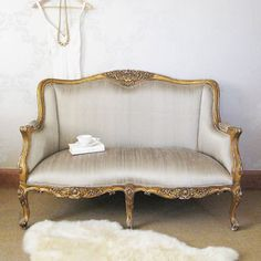 French Provincial sofa. Greystone currently has a settee with similar lines, with tufted velvet upholstery!