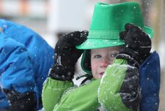 Daniel Luning, 3, watches as the Mineola St. Patrick's Day parade travels down Mineola Boulevard on Sunday, Mar. 1, 2015. Photo Credit: Howard Schnapp