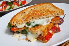 Roasted red pepper pesto, tomato and provolone grilled sandwich... similar to the sandwich posted . I used thin slices of french bread and brushed the outsides with garlic-herb olive oil. On the inside... slices of roma tomato, provolone cheese and roasted red pepper pesto (made by: Cibo Naturals- found in the deli section of our local supermarket ). Grilled on the stovetop... delicious!!