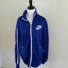 Nike Blue Zippered Jacket Sz L Nike Blue Zippered Jacket Sz L, 100% Polyester, 2 zippered front pockets with white stripe from collar down sleeve.  White Bodice Zipper with Silver Nike pull Nike Jackets & Coats
