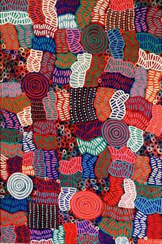 Betty Mbitjana - This painting depicts the designs that the women would paint on their bodies, and the dancing tracks which are made in the sand during women's (awelye) ceremony. Through their awelye ceremonies, women pay homage to their ancestors, show respect for their country and dance out their collective maternal role within their community.