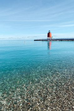 Charlevoix South Pier Light Station viewed from Lake Michigan Park Beach in Charlevoix - one of the top 60 things to do in Michigan! Michigan | USA | United States of America | Travel Destinations | Honeymoon | Backpack | Backpacking | Vacation | Bucket List | Budget | Off the Beaten Path | Local Guide | Wanderlust  #offthebeatenpath #bucketlist #wanderlust #Michigan #USA #America #UnitedStates #exploreMichigan #visitMichigan #seeMichigan #discoverMichigan #TravelMichigan Michigan City, Michigan Travel, Travel Guides, Travel Tips, Travel Destinations, Mackinac Island, Adventure Activities, Packing List For Travel, Travel Articles