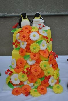 Penguin red yellow orange daisy square tiered wedding cake