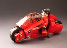 Kaneda's Bike from Akira has appeared here several times over the years, but noattempthad been made ata mini-figure scale version - so difficult is the build even in a large scale - until now. T...