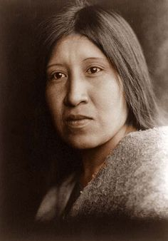 1924 : orotone by Edward Curtis : Native America woman (This photograph was taken in 1924, and shows a Native American woman. The picture was taken by Edward Curtis. Edward Curtis travelled the c...)