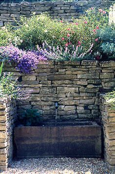 Love the old feel to this.  Probably not realistic, ...unless we use these bricks for the short retaining wall and just cover the tall wall with plants...