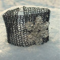 Wire cuff - crochet dark blue wire with beaded snowflake