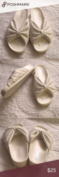 Carlos Santana Slides Never mind Labor Day! Wear white year round. Gorgeous white slides with a bow. Fits close to the foot so no flopping around on your foot. Carlos Santana Shoes Sandals