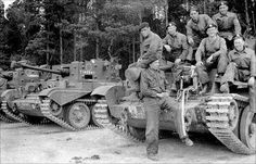 Tankers and Cromwell tanks of 7th Armoured Division (Desert Rats) at one of their pre-D-Day training grounds, either Orwell Park School or Thetford Forest, Spring 1944.