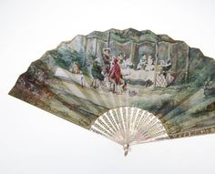 1870 Two-sided fan painted primarily in green, blue, and gray. Scene on one side depicts a wedding banquet set within a garden. Sixteenth-century period clothing is depicted. The other side is blank except for a gold line border. Printed and painted paper, mother of pearl, gold, silver, and copper metals, and mirror. Maker unknown.
