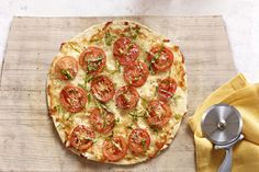Love the aroma of basil and garlic in the kitchen? Our homemade margherita pizza is an easy weeknight dish when you make it with a flour tortilla.