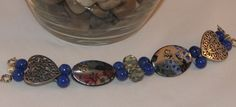 Blue watchband with flower beads $20.00