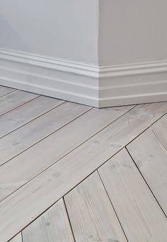 white washed oak floors + white walls