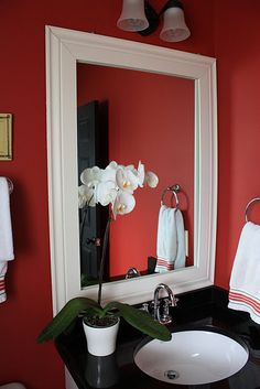 Powder Room: I took the frameless mirror and transformed it into a custom feature by simply glueing a thick frame directly onto the glass. I have shared this link before, it is a great tutorial on this project, Janell Beals How to frame a Mirror.