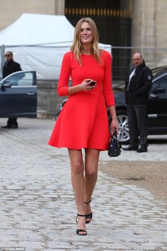 One of the world's most desired:Toni Garrn stood out in scarlet on Friday atChristian Dior's PFW presentation