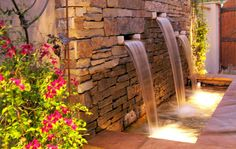 Stone water feature trellis and 12 volt lighting in Mediterranean Courtyard in Denver's Historic Bonnie Brae Neighborhood Mile High Landscaping in Denver