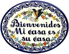 "Embrace your family and friends with ""Welcome, My Home is Your Home"", painted in Spanish on a colorful and striking oval wall plaque!  These authentic talavera welcome plaques are charming enough for any home decor, and feature classical blue and white colors with floral and hummingbird accents.  For a more personal message see our 'Helpful Notes', below."