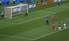 Klaas-Jan Huntelaar of the Netherlands scores a penalty goal past Mexico's goalkeeper Guillermo Ochoa during their 2014 World Cup round of 1...