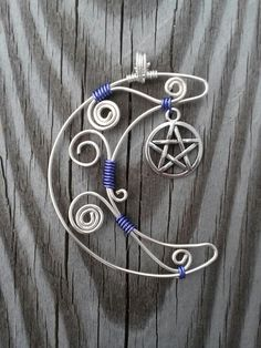 Crescent moon and pentacle pendant https://www.etsy.com/listing/216438023/hand-wire-wrapped-crescent-moon-and