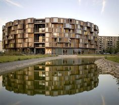 Tietgen Student Hall in the Ørestad district of Copenhagen, is a circular seven-story building with 360 rooms. Designed by Lundgaard & Tranberg Arkitekter.