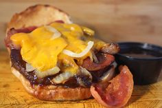 Billy's BBQ Burger: Cheddar, Grilled Onions, Bacon smothered in BBQ Sauce.