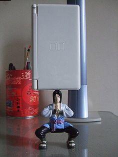 Sasuke figurine that can hold up anything.  I want one!