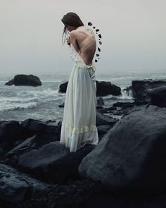 Surreal Photography By 19-Year-Old Alex Stoddard | Bored Panda. Need a stronger backbone? Guess you can just add some rocks to it. >< A weak skinny girl standing in the cold shore of the beach. She needs a stronger backbone which are the stones in order for her too stand up for herself.