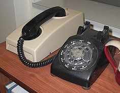 A rotary phone and a dial-up modem; can't get more antiquated.