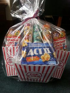 Popcorn basket. 3 act three microwave popcorn boxes, 1 10 pack jolly time mini bags popcorn, 2 3pack cracker jacks, and 3 popcorn seasonings.