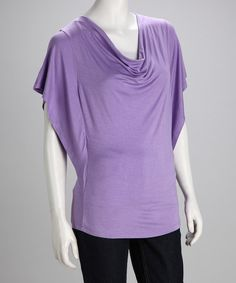 There's no such thing as too many tops, and this casual number knows it. Pretty draping along the collar plays up the dolman-sleeve silhouette, making this soft, stretchy classic a new wear-everywhere staple. Measurements (size S): 22'' long from center back neckline to hem95% rayon / 5% spandexHand wash; dry flat