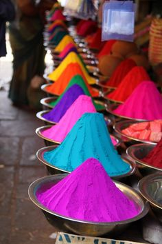 The Pigment Merchants in North Africa and West Asia. Piles of pigmented powders displayed in silver bowls are sold along the streets in Marrakesh, Morocco (and often found in India, as well). These pigments are used in paint, pottery, ink, dyes, and other artistic aesthetics.