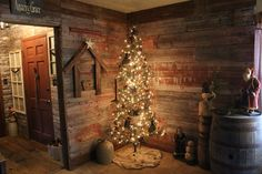 Primitive Christmas..Corner of my family room just put that barn wood on the walls. Foyer to the left is also all barn wood.