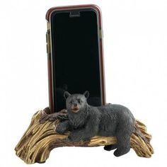 Let your phone hibernate in style with this charming holder. It looks like a piece of driftwood with a lounging black bear resting in front, but it's a high-tech phone holder that's the perfect place to keep your smart phone while not in use. Desk Phone Holder, Smartphone Holder, Mobile Smartphone, Martial Arts Supplies, Discount Cell Phones, Cell Phone Deals, Bear Decor, Rustic Cabin Decor, Rustic Cabins