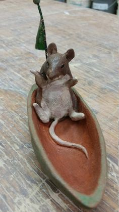Check out this item in my Etsy shop https://www.etsy.com/listing/288526239/ceramic-mouse-in-boat-with-sari-pennant