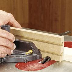An adjustable wooden extension is an easy and inexpensive improvement for your tablesaw miter gauge.