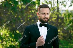 Bridegroom bewhiskered in a park      #bewhiskered #bridegroom #park #spring #caucasian #quiet #calm #beardie #white #necktie #suit #portrait #mustache #attractive #european #youth #beard #handsome #man #smiling #young #peace #guy #smile #male #nice #peaceful #youthful #groom