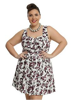 "<div>A floral dress can be dark and mysterious without being black, and this dress is proof. The white dress features an allover burgundy flower and skull print. The fitted bodice has a flattering gathered sweetheart neckline with wide tank straps. A fitted waistline can be emphasized even more by the back lace-up corset detail. The full circle skirt will have you spinning with happiness! Side zipper closure. </div><div><ul><li style=""list-style-position: inside !important; list-style-t..."
