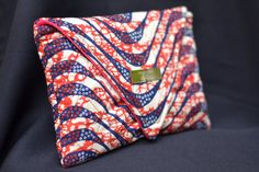 Classic made interesting...African Print Red & Navy Wave Clutch from FlorenceHouse1973 on Etsy  www.etsy.com/shop/FlorenceHouse1973