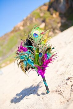 Peacock and feathers bouquet. Might be cheaper than flowers .