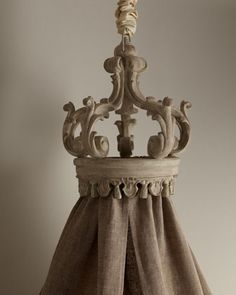 """Monarch"" Bed Crown at Horchow.com  {this is so you can drape fabric through it and let it cascade onto the bed/floor and you can live like a king/queen!!!}"
