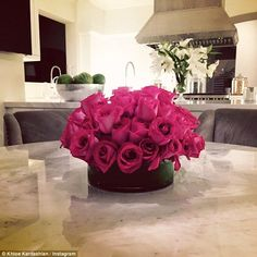 From an admirer?: Single Khloe Kardashian shared a photo on Thursday of a bouquet of hot pink roses placed in the kitchenette of the Calabasas mansion she bought from Justin Bieber in March for $7.2m
