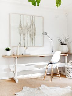 White decor with photography framed in white. #Style #Interior #Office